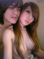 Asian couple takes naughty pics at home
