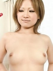 Ai Shirosakia Asian with fingers in shaved cunt licks vibrator