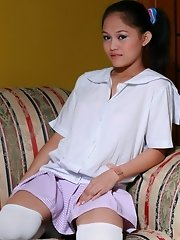 Cute Emelie strips from her school uniform and spreads the lips of her brown pussy