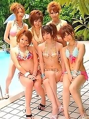 Asian girls pose in bikinis outside