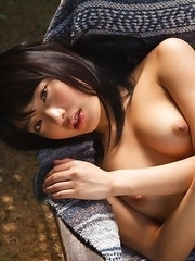 Kana Yume shows nude playful tits and hairy cunt in nature