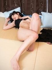 Bush-sporting JAV hottie Shino Aoi using her perfect feet in a footjob scene